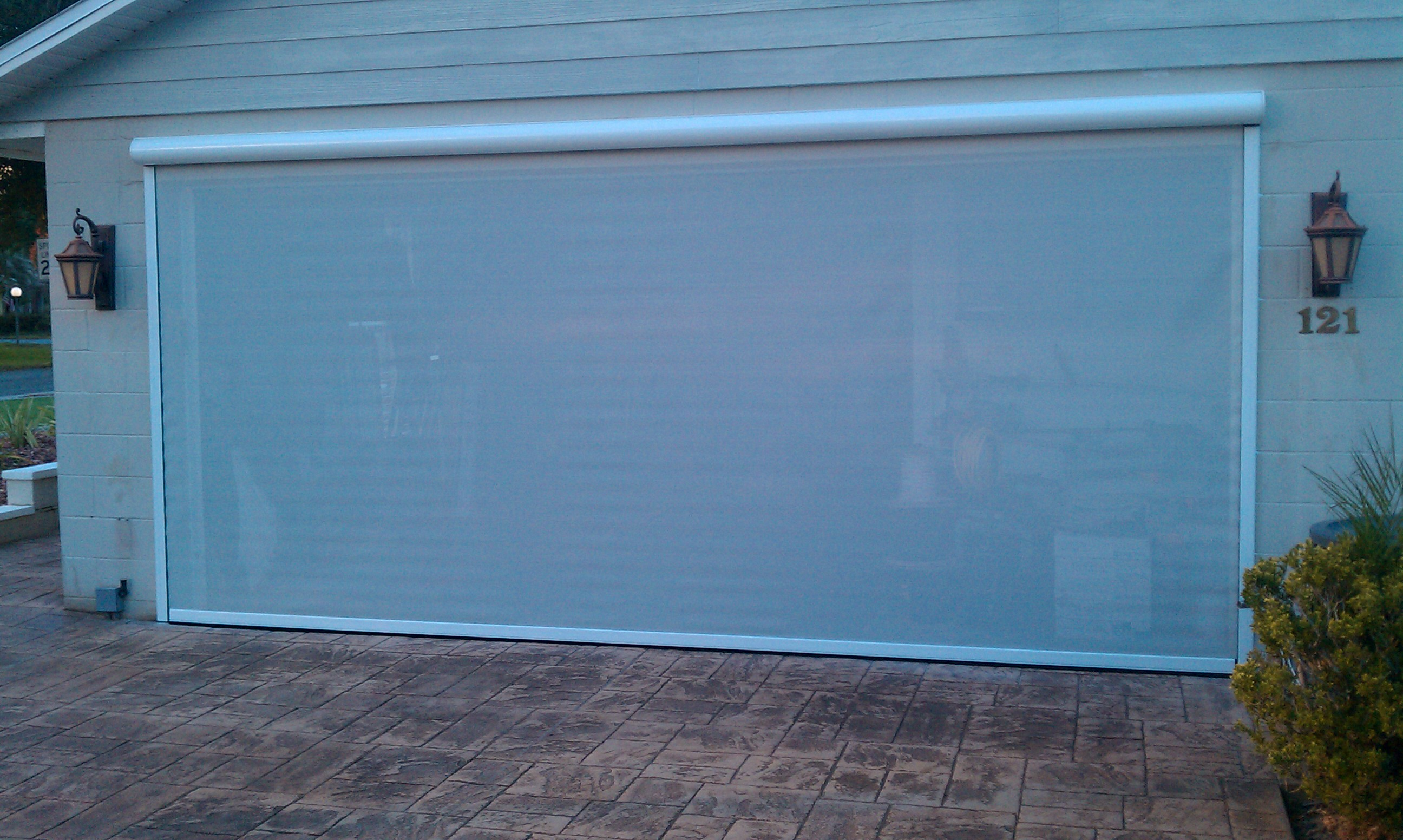Garage door2 gulf coast retractable screens for Motorized garage door screens