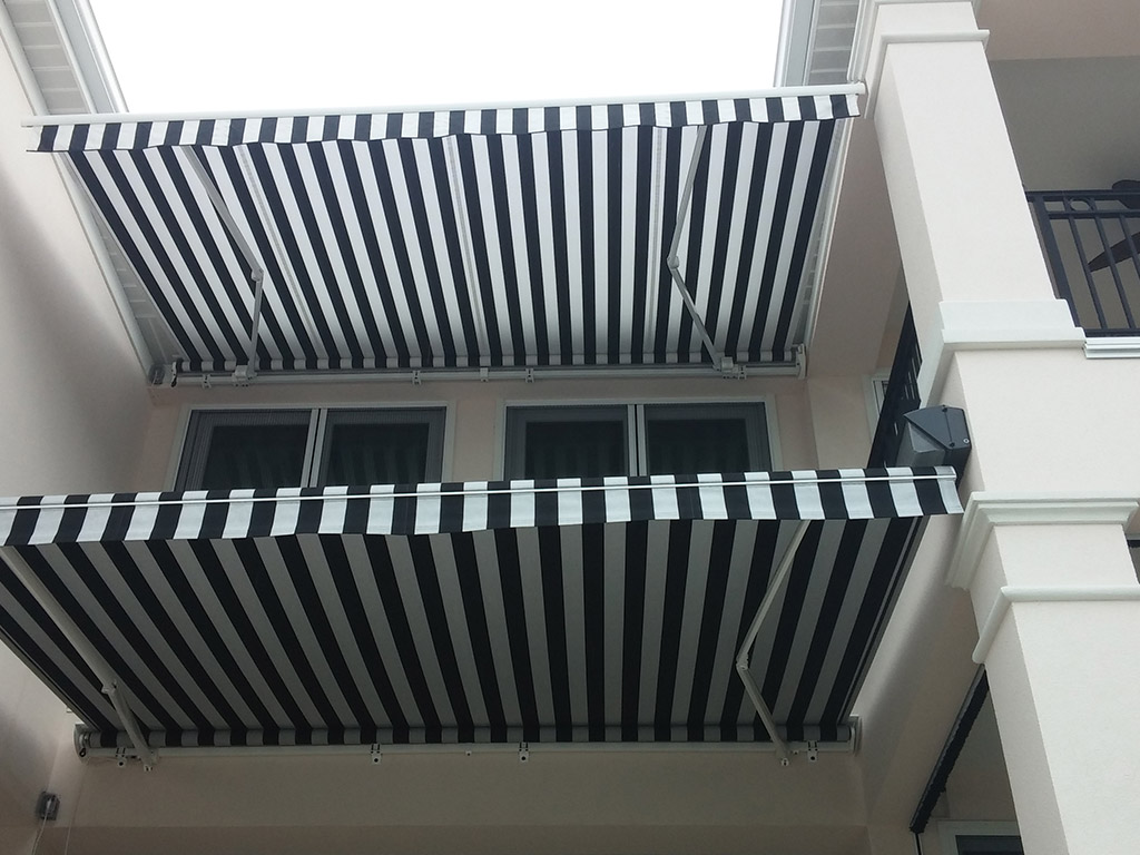 Awning11 gulf coast retractable screens for Automatic retractable screens